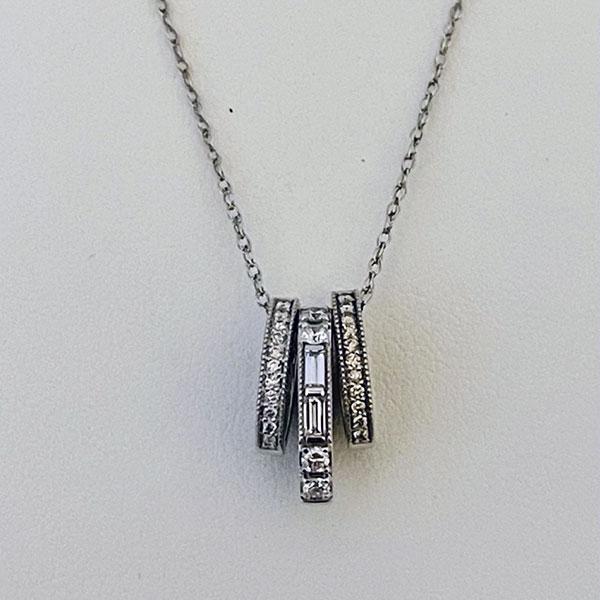 3 piece baguette/round diamond pendant